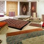 Arabic carpet shop exhibition colorful carpets — Stock Photo