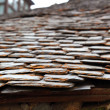 Slate stone roof tiles perspective selective focus - Stock Photo