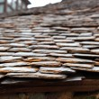 Slate stone roof tiles perspective selective focus — Stock Photo #5511057
