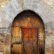 Romanesque arch door wooden medieval Ainsa - Stock Photo