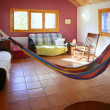 Living room in warm colors, mexican hammock - Stock Photo