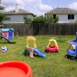 Children colorful playground at home green grass — Stock Photo #5511523