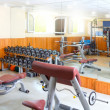 Gym interior bodybuliding weights exercise room — Stock Photo