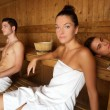 Photo: Sauna spa therapy young group in wooden room