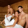 Sauna spa therapy young group in wooden room — Foto de stock #5511545