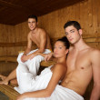 Foto Stock: Sauna spa therapy young group in wooden room