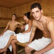 Sauna spa therapy young group in wooden room - Stock Photo