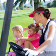 Golf course family mother and daughters in buggy — Stock Photo #5511556