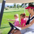 Golf course family mother and daughters in buggy — Stock Photo