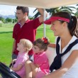 Golf course family father mother daughters buggy - Zdjęcie stockowe