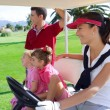 Golf course family father mother daughters buggy - Foto de Stock