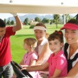 Golf course mothers and daughters in buggy — Stock Photo