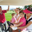 Golf course mothers and daughters in buggy — Stock Photo #5511563