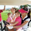 Foto Stock: Golf course mothers and daughters in buggy