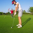 Golf woman player green putting hole golf ball — Stock Photo