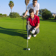Golf young man looking and aiming the hole — Stock Photo #5511587