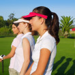 Golf three woman in a row green grass course — Stock Photo #5511599