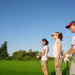 Golf three woman in a row green grass course — Stock Photo