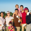 Golf course group of friends with children - Stock Photo