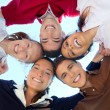 Friends happy group in circle heads from below — Stock Photo