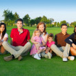 Family friends group sitting green grass — Stock Photo