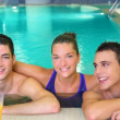 Spa young friends group smiling on turquoise pool — Stock Photo
