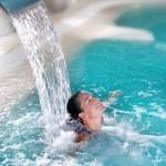 Spa hydrotherapy woman waterfall jet — Stock Photo