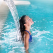 Spa hydrotherapy woman waterfall jet — Stock Photo