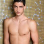 Tile bathroom shower young nude man posing sexy — Stock Photo