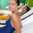 Spa relax room hammock row beautiful girl — Stock Photo #5511660