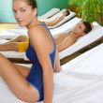 Spa relax room hammock row beautiful girl — Stock Photo