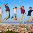 Foto Stock: Jumping young group on city buildings