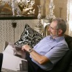 Senion man reading sofa luxury living room — Stock Photo