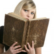 Beautiful blonde student girl with old book — Stock Photo