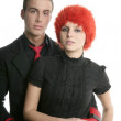 Couple of orange wig woman and handsome boxer man — Stock Photo #5511892