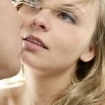 Beautiful blond woman kissing man — Stock Photo