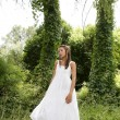 Magic woman in the forest, long white dress — Stock Photo