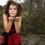 Beautiful woman, black magic on burned forest — Stock Photo