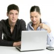 Young couple teamwork cooperation with laptop — Stock Photo #5512161