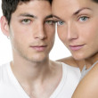 Beautiful young couple closeup portrait over white — Stock Photo