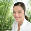 Beautiful headset woman in an forest — Stock Photo