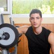 Gym young man posing bodybuilding weigths — Stock Photo