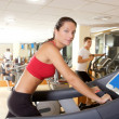 Gym treadmill running young woman interior - Stock Photo