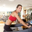 Gym treadmill running young woman interior — Stock Photo #5512480