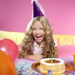 Happy little blond girl in a birthday party laughing with candle — Stok fotoğraf