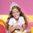 Little blond birthday party girleating cake with hands — Stock Photo #5512530