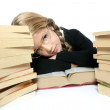 Little blond bored student girl thinking relaxed on book — Stock Photo #5512538