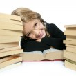 Little student blond braided girl smiling with stacked books — Stock Photo #5512541