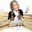 Little student blond braided girl smiling with stacked books — Stock Photo