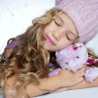 Winter fashion cap little girl hug teddy bear smiling - 图库照片